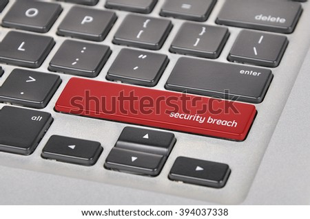 The computer keyboard button written word security breach . - stock photo