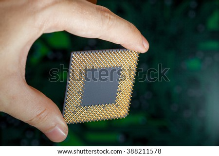 The computer processor with legs in the master's hand. - stock photo