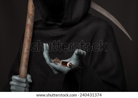 The concept: drugs kill. Angel of death holding syringe with heroin. Studio shot over black background - stock photo