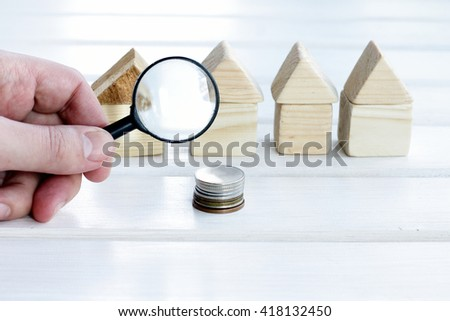 the concept of a careful study of real estate market/beneficial and suitable home - stock photo
