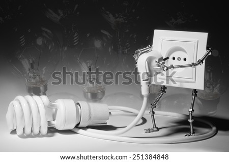 The concept of a new generation of lamps. The socket connects to fluorescent lamp on the background incandescent lamps. - stock photo