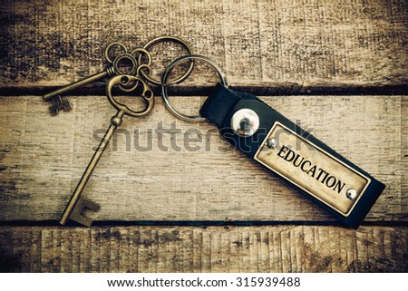 The concept of 'education' is translated by key and silver key chain - stock photo