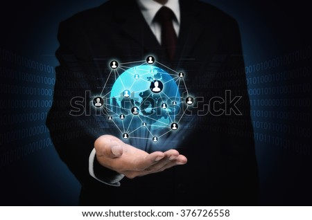 The concept of internet business connection. Businessman holding a network of people and contacts