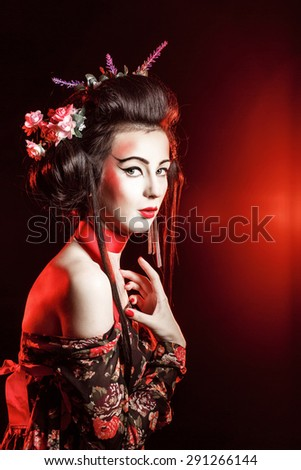 The concept of Japanese traditions. Geisha with traditional makeup and hairdo. - stock photo