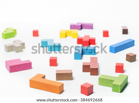 The concept of logical thinking. Mind games, psychology, the search for solutions.  Geometric shapes, tetris toy wooden blocks. - stock photo