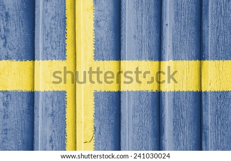 The concept of national flag on old ribbed wooden background: Sweden - stock photo