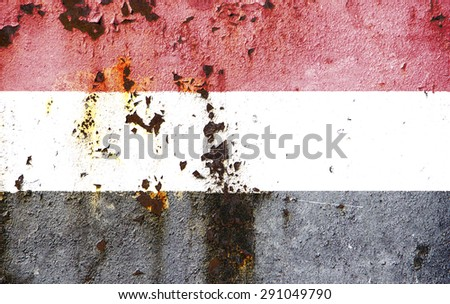 The concept of national flag on rusty metal texture: Yemen