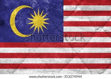 The concept of national flag on stitched canvas background: Malaysia - stock photo