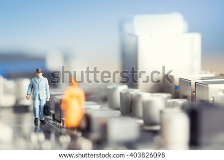 The concept of  people walking in a maze of microcircuit like the city. The concept of humanization of relations between the user computer and the computer. - stock photo