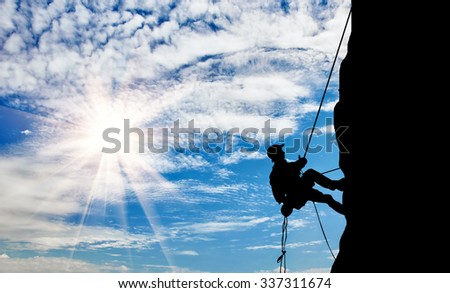 The concept of perseverance. Silhouette climber steadily climb the mountain - stock photo