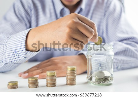 The concept of savings money / Businessman hand stack coins to the idea of growing the business and the wealthy.