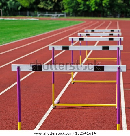 The concept of sport - the barriers on the treadmill stadium. - stock photo