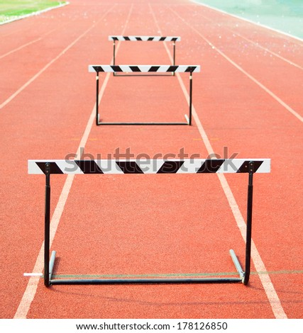 The concept of sport - the barriers on the treadmill stadium - stock photo