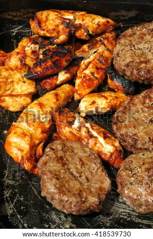 The concept of sunny summer days with Golden chicken & sizzling burgers on a tray ready to eat