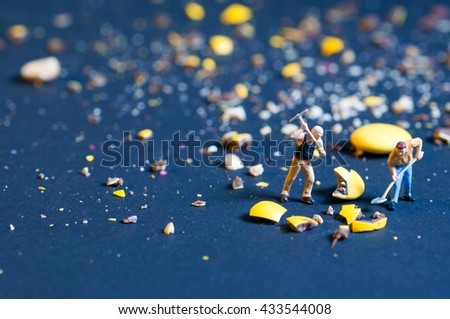 The concept of the miniature worker with a shovel - stock photo