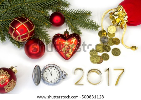 The concept of the New Year and Christmas. Composition of clock and christmas decorations, purse with coins, inscription 2017.Isolate.