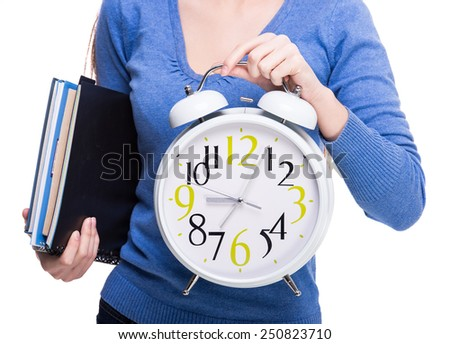 The concept of time. Close-up of young female student with clock isolated on white background. - stock photo