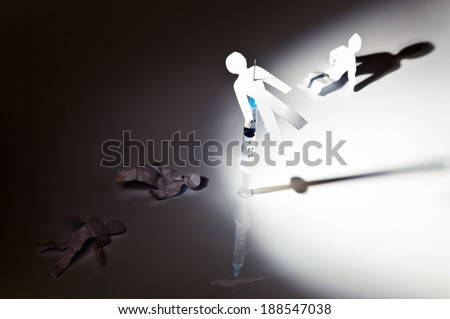 The conceptual image on a theme of narcotic dependence, a white reflective background. - stock photo