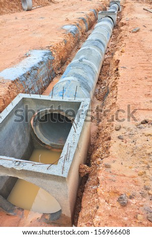 The Concrete drainage tank on construction site - stock photo