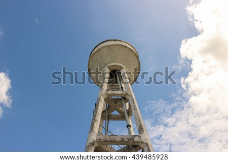 The concrete water tower tank under blue sky and white cloud for water supply at countryside in thailand   - stock photo