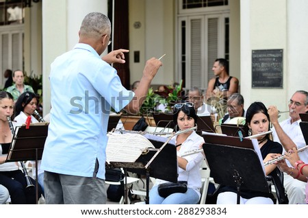 The conductor with brass band in Havana, Cuba on May 10, 2013 - stock photo