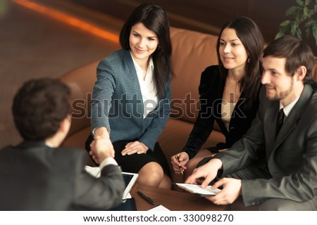The conference of entrepreneurs. Concluding a very important deal for the company. - stock photo