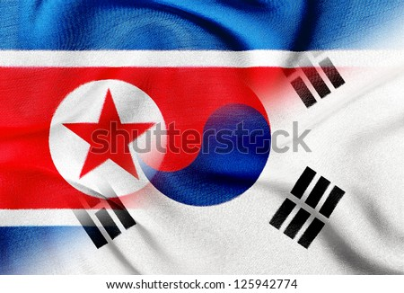 The confrontation between North Korea and South Korea. Fabric Texture flags. - stock photo