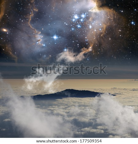 The connection between heaven and Earth. Elements of this image furnished by NASA. - stock photo
