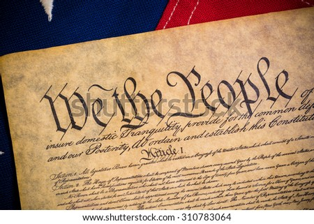 The constitution of the United States of American with a vintage flag - stock photo