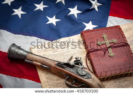 The constitution protects among others both the right to bear arms and freedom of religion, illustrated with a musket type pistol ( flintlock pistol ) and a bible