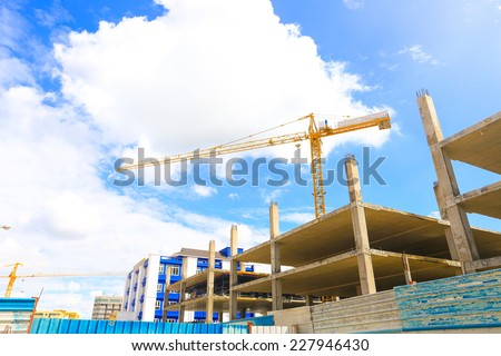 The construction crane on day with sky - stock photo