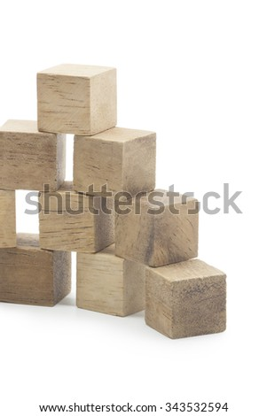 The Construction from wooden blocks. It is isolated on a white background - stock photo