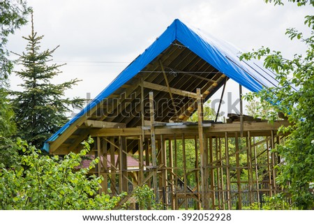 The construction of a house on the garden