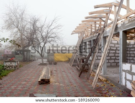 The construction of the roof of a one-storey building with their hands