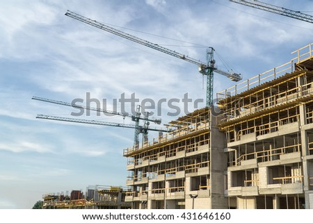 The construction site. Construction of the new residential building. Construction cranes. - stock photo