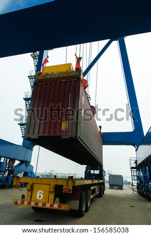The container is lifting - stock photo