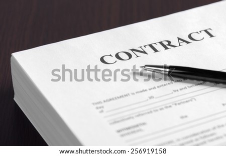 The contract on desktop, selective focus image on sign a contract - stock photo