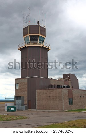 The control tower at a small airport. From this tower controllers direct air traffic on the ground and in the air immediately around the airport. - stock photo