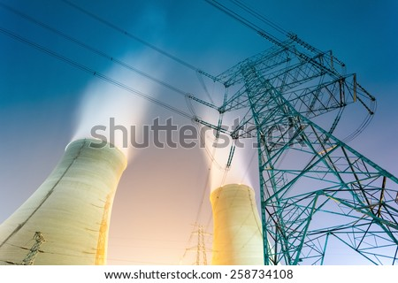 the cooling towers at night of the nuclear power generation plant - stock photo