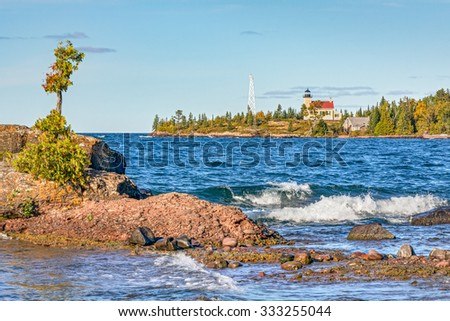 The Copper Harbor Light is a lighthouse is found on the Keweenaw Peninsula of Upper Michigan. - stock photo