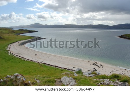 The Coral Bay near Dunvegan, Skye with the sun breaking over Loch Dunvegan - stock photo