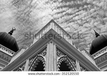 The corner structure of a Mogul architectural Islamic Mosque named Zahir Mosque in Kedah, Malaysia, processed in monochrome. - stock photo