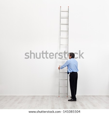The corporate ladder - businessman at the start of carrier, begin climbing - stock photo