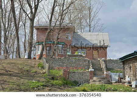 The country-cottage with vegetable-garden and bathhouse.