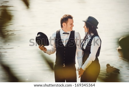 The couple in front of the river  - stock photo