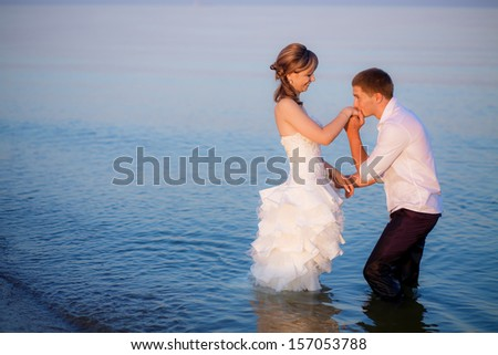 the couple in the sea - stock photo