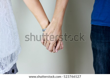 the couple of love holding hand each other