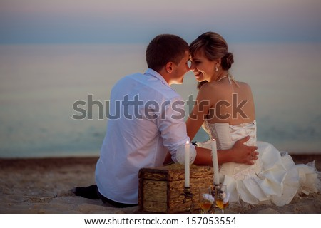the couple on the beach at night - stock photo