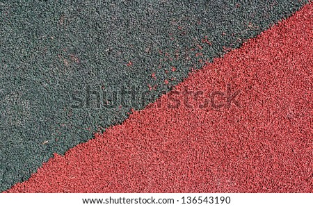 The covering from a rubber crumb(rubber asphalt) is used in stadiums for running track & field. Running track rubber cover texture for background - stock photo