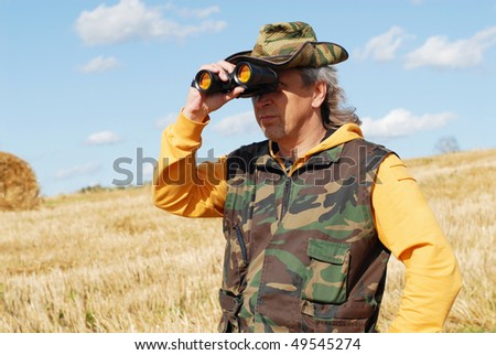 The cowboy on a background of field and sky - stock photo